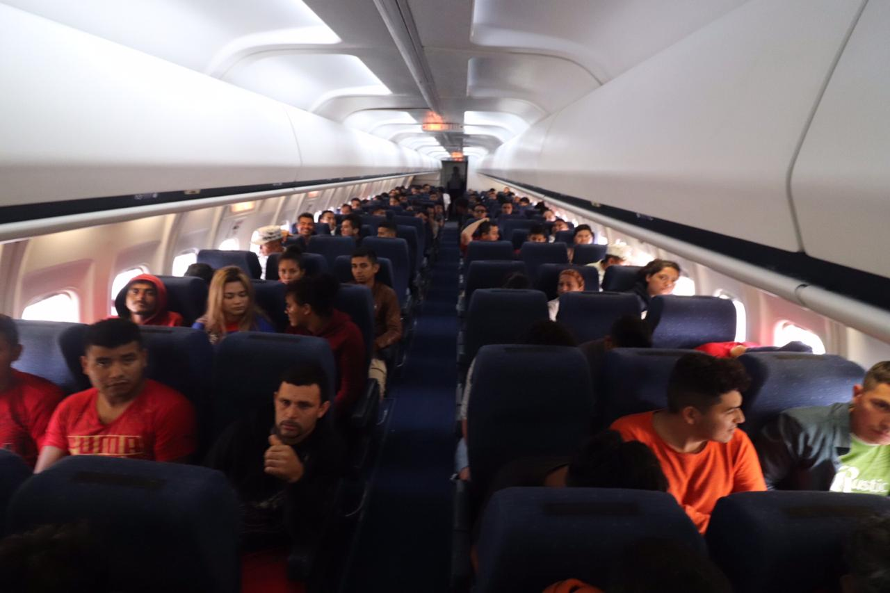 240 retornados de caravana llegan a San Pedro Sula procedentes de México